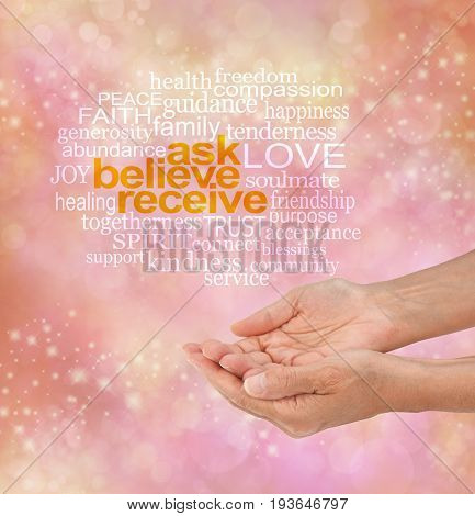 If you don't ask, you don't get - pink, orange and yellow sparkling bokeh background with white words ASK BELIEVE RECEIVE surrounded by a relevant word cloud and cupped hands beneath stock photo