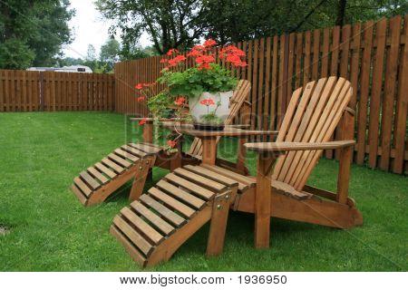 Patio furniture on green lawn.General garden patio stock photo