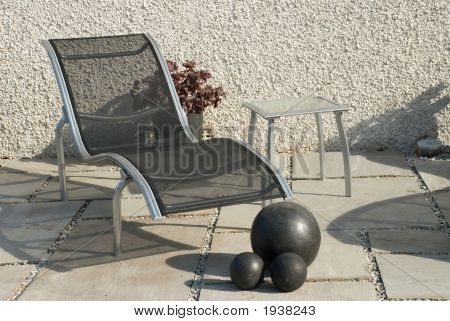 modern garden furniture on patio for relaxtion stock photo