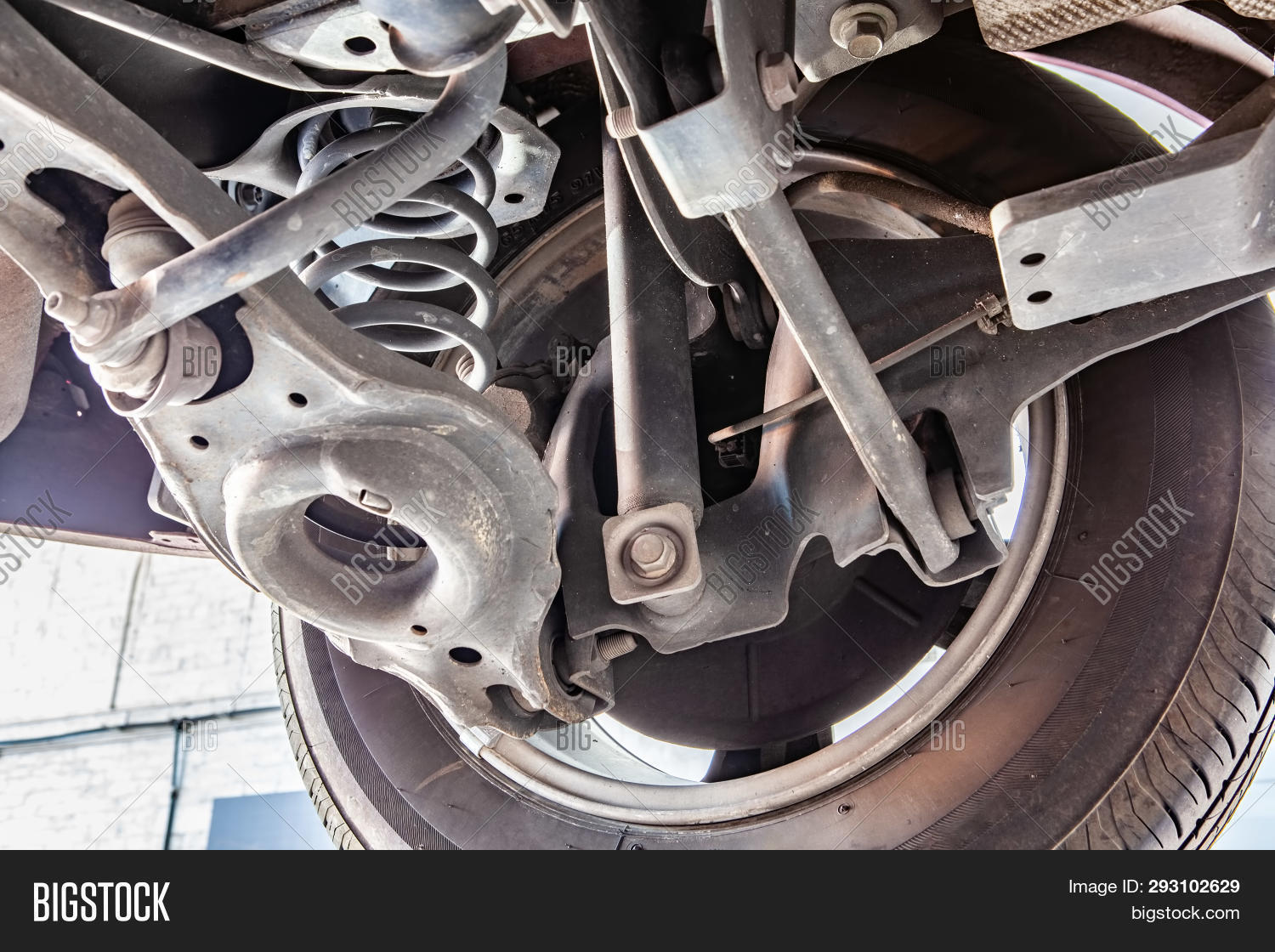 Metal,Spring,Station,Steel,Technology,absorber,auto,automobile,automotive,axle,brake,car,carriage,chassis,check-up,closeup,coil,engineering,equipment,fixing,frame,hoist,hydraulic,industrial,inspection,lift,maintenance,mechanical,pipes,power,repair,safety,service,servicing,shock,shop,suspension,system,transportation,tuning,under,underbody,undercarriage,underneath,vehicle,wheel,workshop