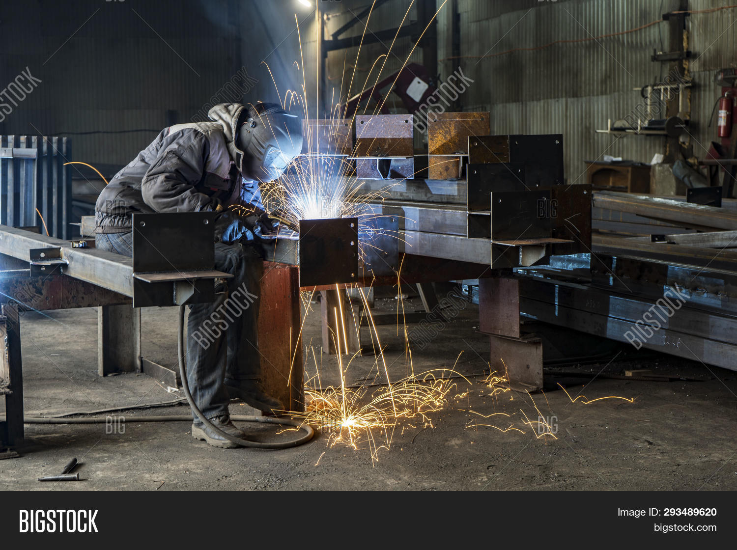 Welding with sparks by Process fluxed cored arc welding , Industrial steel welder part in factory welder Industrial automotive part in factory.
