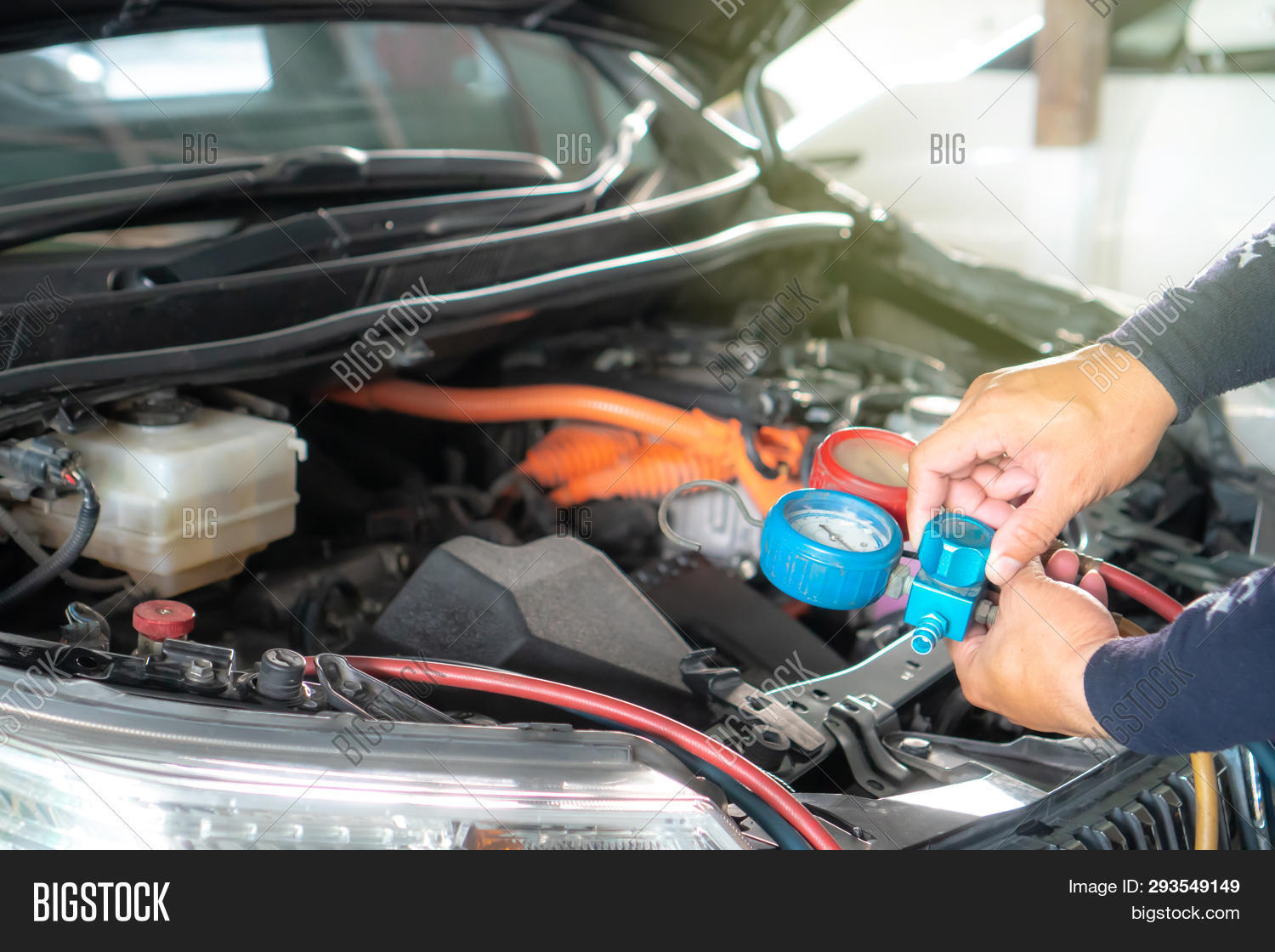 ac,air,auto,automobile,automotive,background,car,check,closeup,condition,conditioner,conditioning,cool,engine,equipment,filling,fixed,freon,garage,hand,indicator,industry,maintenance,man,mechanic,meter,monitoring,pipe,pressure,recharge,refrigerant,repair,service,system,technology,tool,transportation,unit,vehicle,white,work