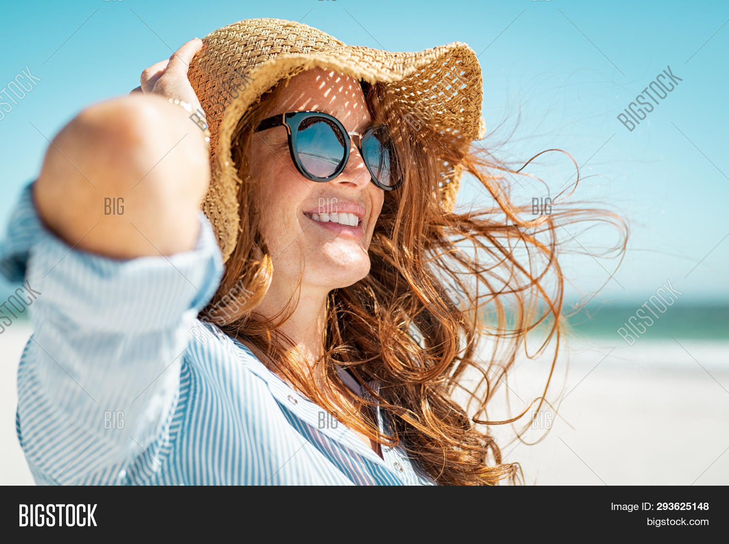 attractive,beach,beautiful,breeze,care,carefree,carefree woman,cheerful,enjoying,face,fun,girl,hair,happiness,happy,hat,holiday,lifestyle,looking away,mature,mid adult woman,middle aged woman,people,pretty,protection,red,relax,sea,seaside,shades,skin,skin care,skincare,smile,straw,straw hat,summer,sun,sunbath,sunglasses,tanning,thinking,toothy smile,travel,tropical,vacation,wind,windy hair,young,young woman