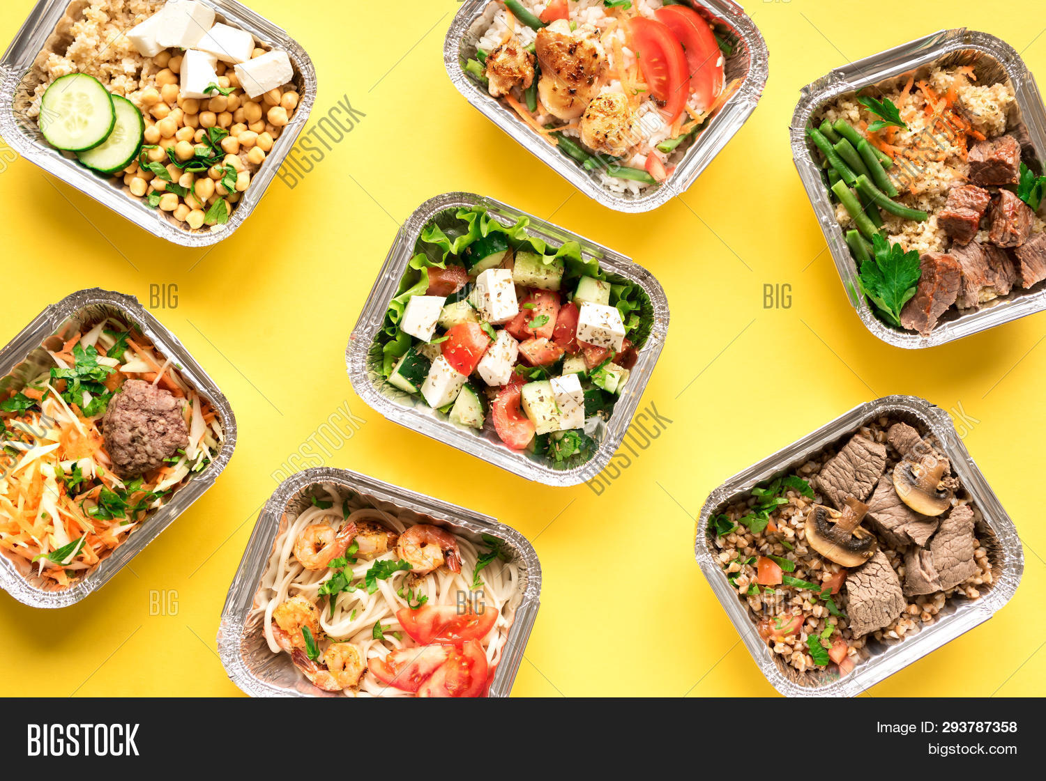 Healthy food delivery. Take away of organic daily meal on yellow, copy space. Clean eating concept, healthy food in foil boxes, fitness nutrition plan, top view.