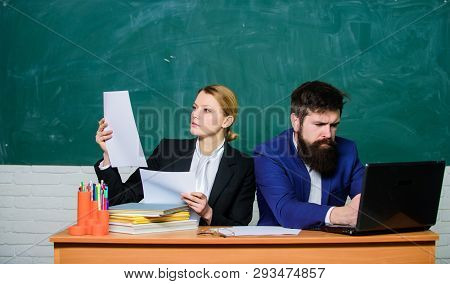 Teacher And Student On Exam. Back To School. Formal Education. Businessman And Secretary. Paper Work