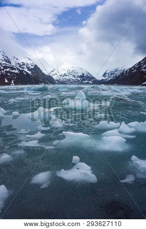 Melting Ice at Portage Lake in Alaska on a beautiful summer day stock photo