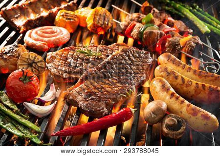 Assorted delicious grilled meat with vegetables sizzling over the coals on barbecue stock photo