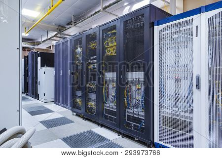 Control Modules With Modern Communication Equipment, Switches And Cables In Server Room. Data Center