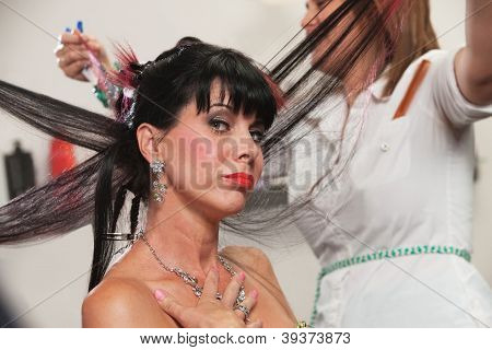 Pouting lady with hair straightened in hair salon stock photo