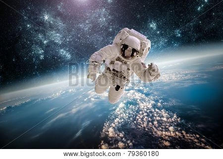 Astronaut in space against the scenery of the planet earth. Components of this picture outfitted