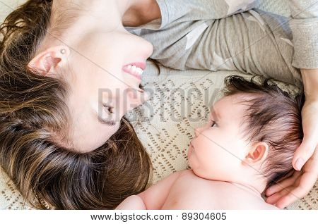 Portrait Of Happy Beautiful Mother And Cute Newborn Baby Girl