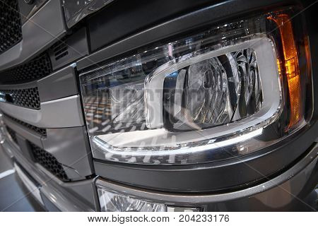 View on car truck cabin front light with hard plastic cover. Car light close up. Truck hood cabin cover. Car truck led light. Stylish modern truck led head light on cabin hood stock photo