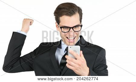 Happy bussinessman holding smartphone and celebrating his success good news stock photo