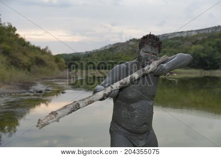 Man Mud Bath Game Spa Gun Fun Resort stock photo
