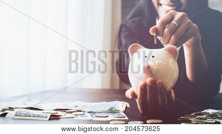 Beautiful young business girl saving money for holiday season saving money concept