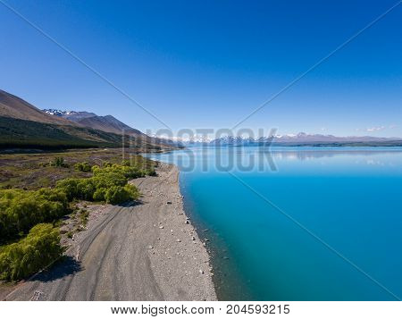 Aerial view of Mt Cook landscape captured by drone at Lake Pukaki Aoraki Mt Cook National Park New Zealand. Mt Cook the highest mountain of New Zealand is the prominent destination for tourist. stock photo
