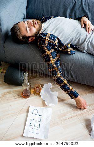 Alcohol drunkard man is drinking himself to sleep stock photo