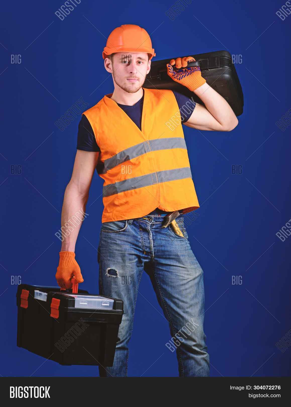 background,beard,bearded,blue,build,builder,calm,carry,case,caucasian,concept,construction,constructor,contractor,developer,engineering,equipment,equipped,face,guy,handsome,handyman,hard,hat,helmet,helpful,hold,laborer,man,mechanic,problem,professional,ready,repair,repairer,repairman,service,shoulder,solve,strong,suitcase,technician,tool,toolbox,uniform,unshaven,work,worker