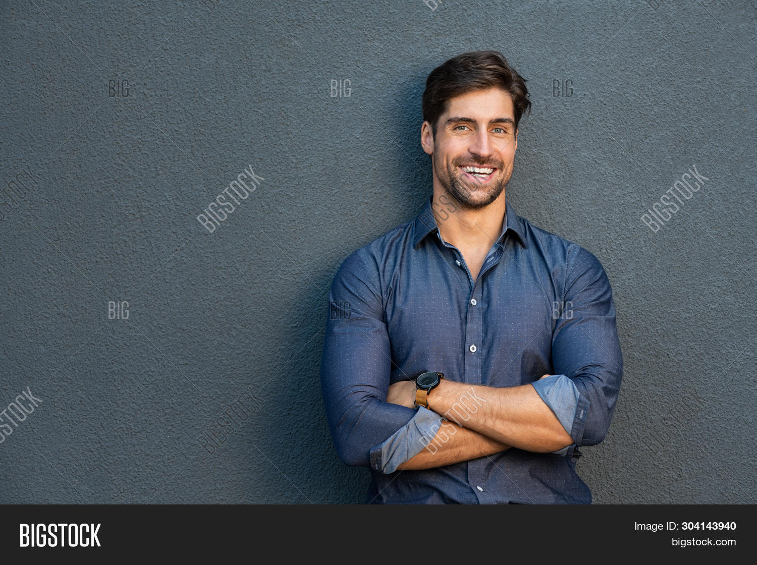 attractive,background,business,business casual,business man,businessman,casual,casual business,cheerful,confident,copy space,crossed arms,expression,face,friendly,gray,gray background,grey background,grey wall,guy,handsome,handsome man,happy,hispanic,isolated,joyful,latin,laugh,looking,looking at camera,mid adult man,people,portrait,pride,professional,proud,reliability,satisfaction,satisfied,smile,standing,stylish,success,successful,toothy smile,wall,work,young,young man