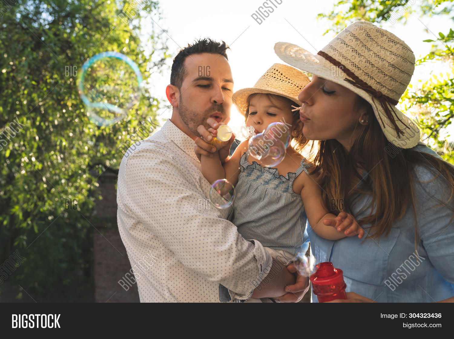 Happy Hispanic Family Having Fun Together Outdoors.