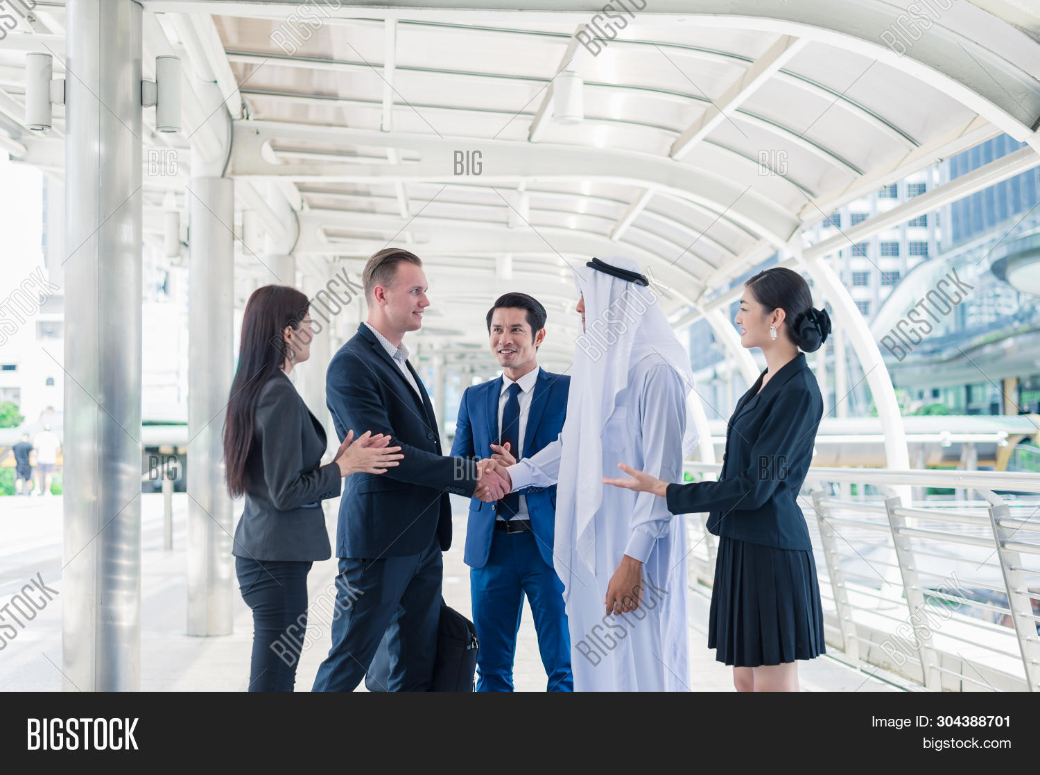 Multi-ethnic Businessman Standing And Shaking Hand In The City For Successful In Business Cooperatio