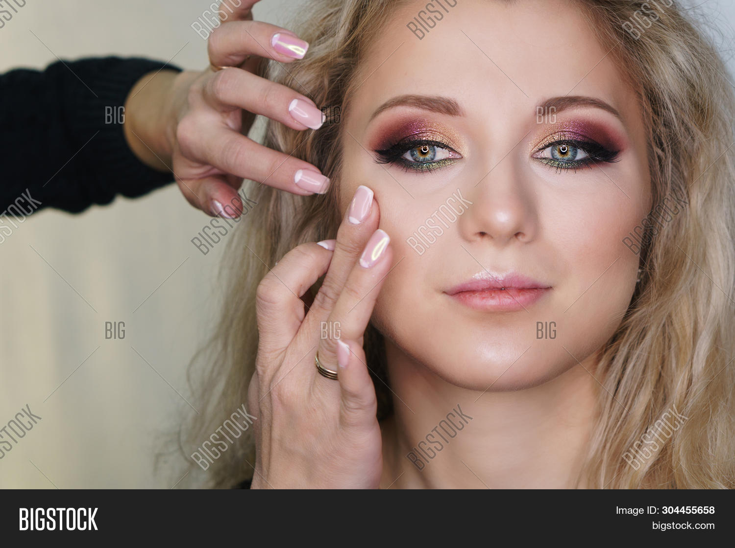 Make-up Artist Working In Make-up Studio, Applying Makeup On Face Of Female Clients. Makeup Artist E