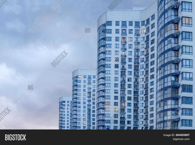 architecture,background,balconies,blocks,brick,building,capital,city,clouds,cloudy,coat,complex,concept,development,dusk,european,exterior,fragment,glass,home,hotel,house,huge,luxury,monolithic,outside,skyscrapers,twilight,wave