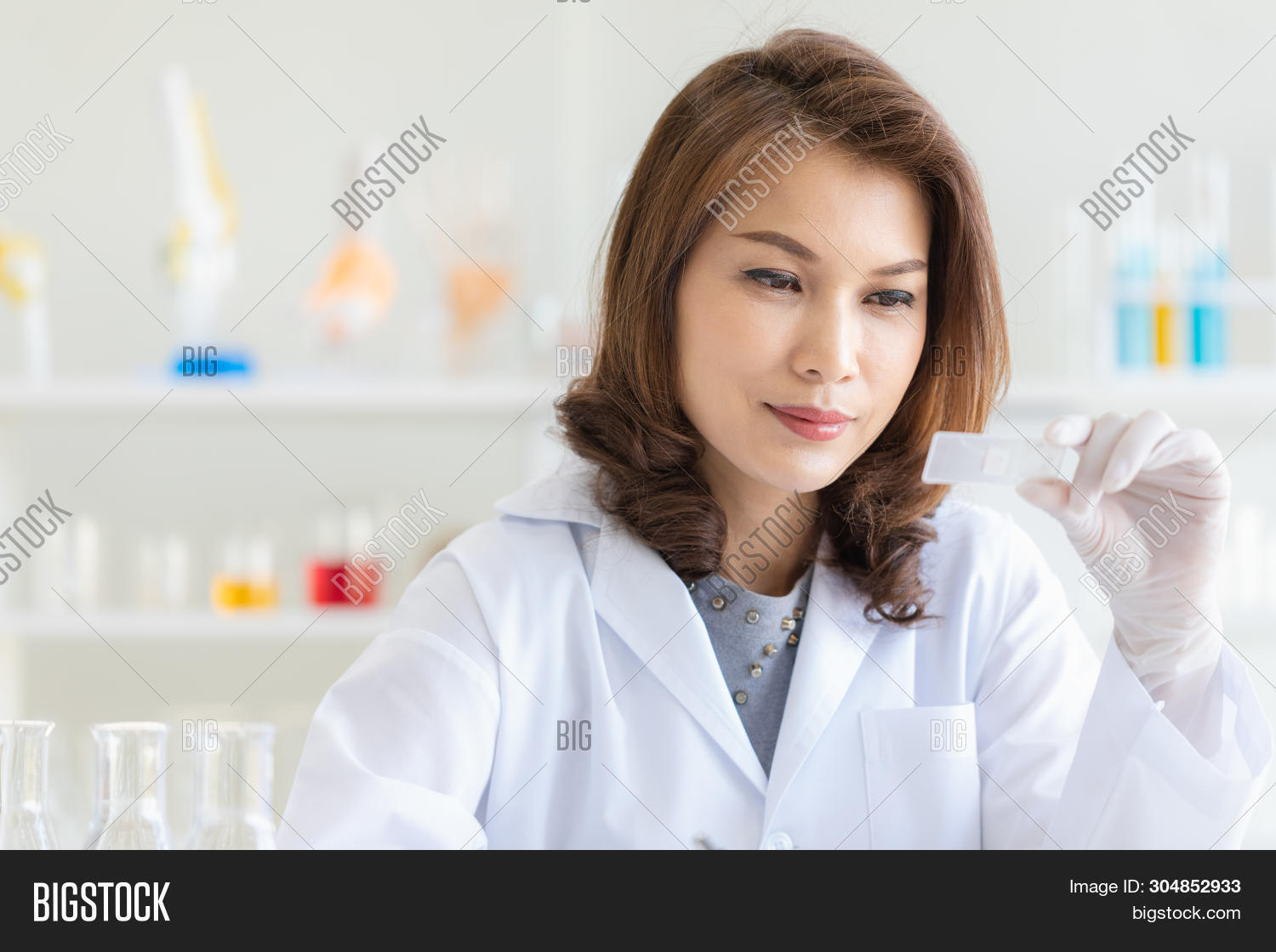 analysis,asian,background,beaker,beautiful,beauty,biology,biotechnology,chemical,chemistry,clinic,close,coat,discovery,equipment,experiment,female,hand,hold,lab,laboratory,leader,looking,medical,multicultural,occupation,pad,pharmacy,portrait,poses,posing,research,result,sample,science,scientific,scientist,smiling,something,standing,study,test,tool,tube,up,white,woman,work,young