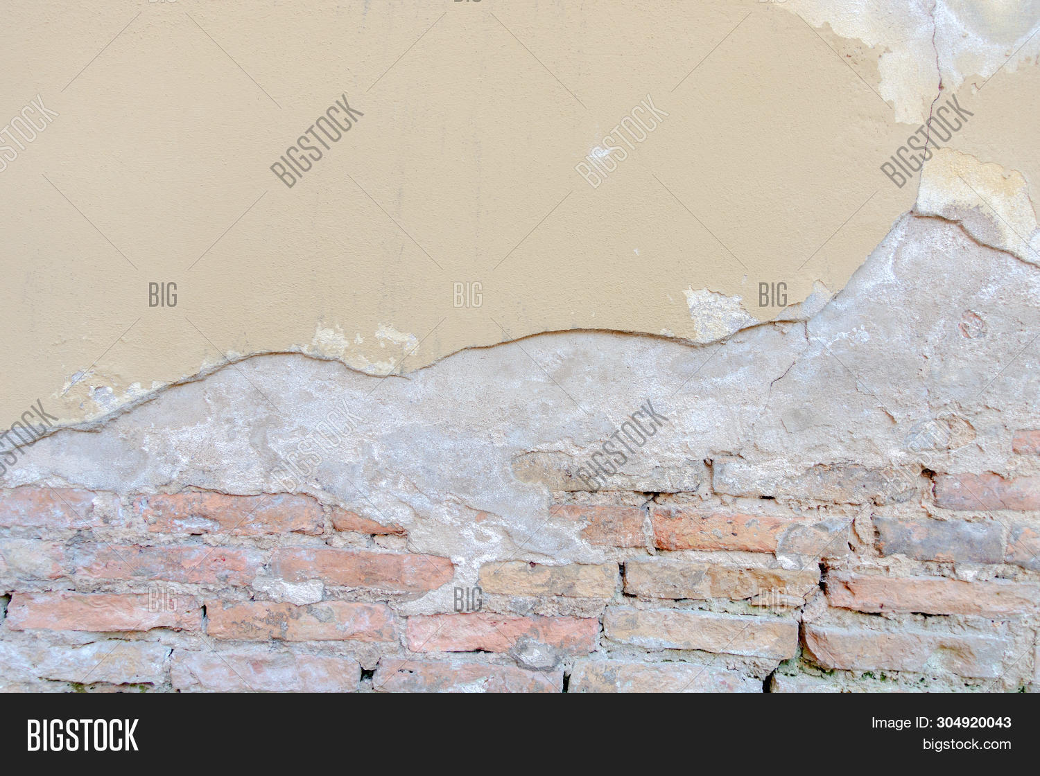 Old Grungy Red Brick Wall With Peeled Beige Stucco Background. Vintage Retro Plaster Wall With Dirty