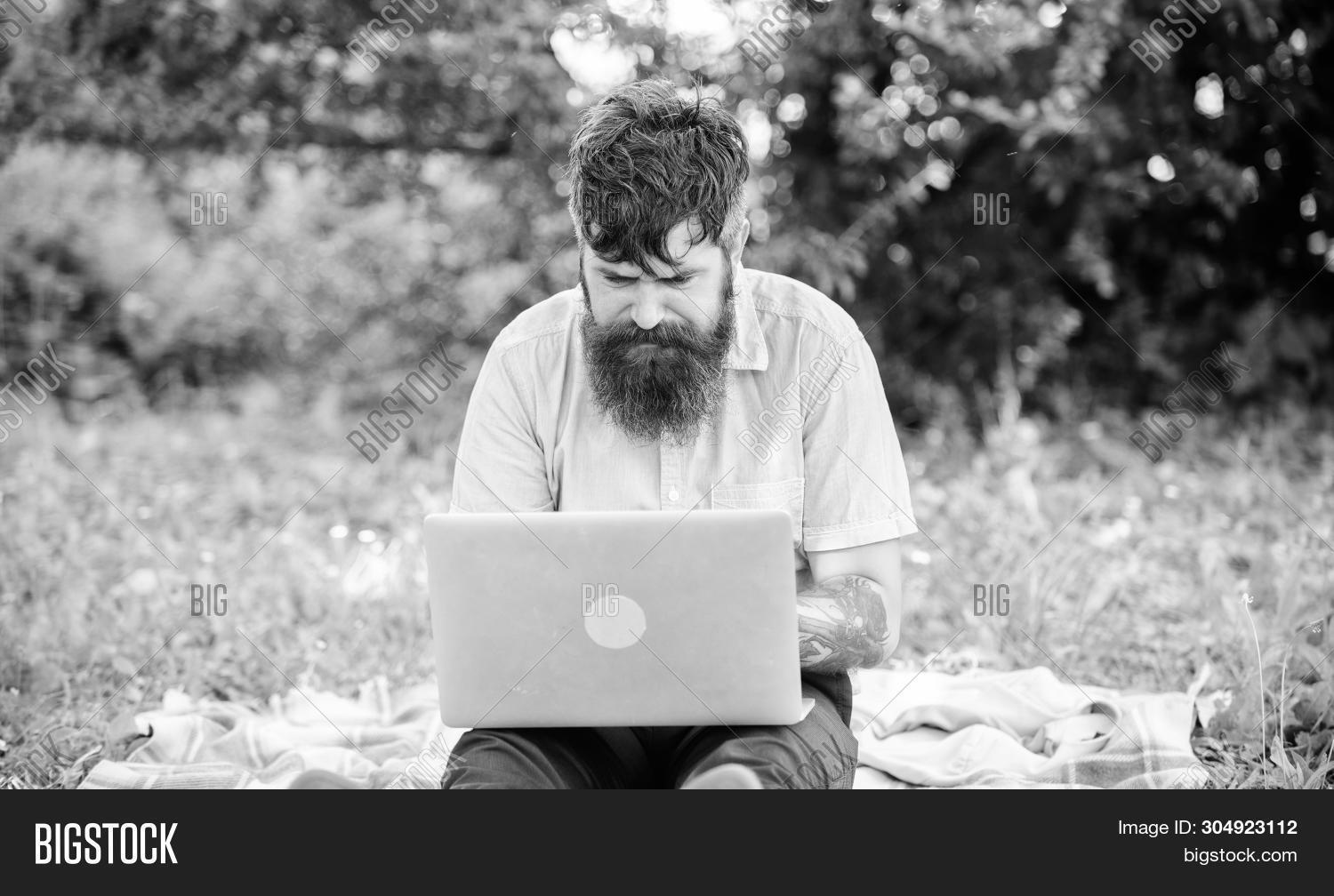 Looking For Inspiration. Blogger Becoming Inspired By Nature. Man Bearded With Laptop Sit Meadow Nat
