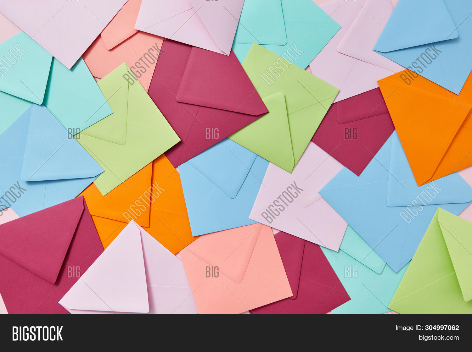 Creative background from handcraft colored blank envelopes and letters.