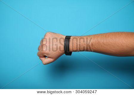 Concert black paper bracelet mockup, event wristband. Arm activity accessory, adhesive, cheap. stock photo