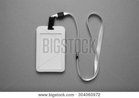 Badge mockup, name tag on grey background. White identification card. Mockup. stock photo
