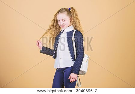 Popular useful fashion accessory. Schoolgirl with small leather backpack. Carry bag comfortable. Stylish mini backpack. Learn how fit backpack correctly. Girl little fashionable cutie carry backpack stock photo