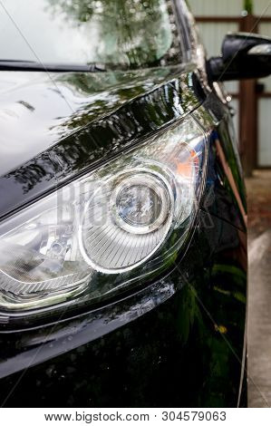 Outdoor car wash. Gentle Car Washing. Modern Car Covered by soap and Water. automobile, auto wash foam water, Auto detailing or valeting concept. Selective focus. stock photo