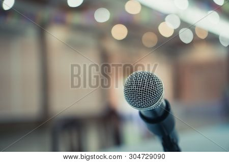 Microphone on abstract blurred conference hall prepare for speaker on stage in seminar room. lecture to audience university with bokeh background. Business meeting or education teaching image stock photo