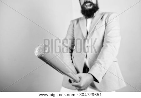 Hands hold big wooden baseball bat symbol male genitals imitating erection. Secrets of good erection. Testosterone booster. Health and male sexuality concept. Male health and erection. Sexual potency stock photo