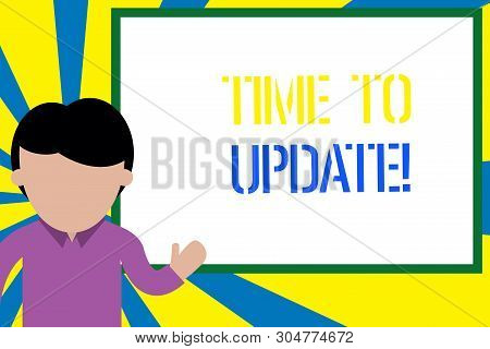 Conceptual hand writing showing Time To Update. Business photo text act updating something someone or updated version program Man standing in front whiteboard pointing to project photo Art. stock photo