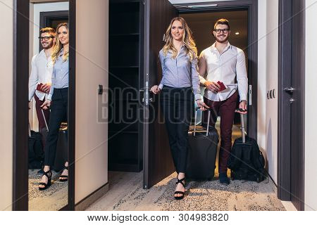 Vacation for couple. Young couple entering the hotel room together stock photo