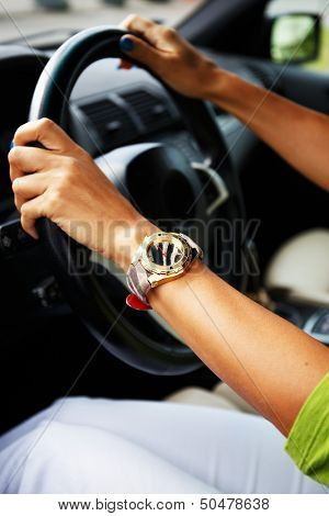 Woman hands on a steering wheel stock photo