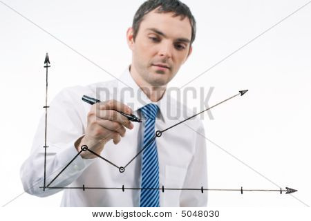 Photo of graph being drawn by confident businessman at background stock photo