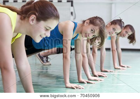 Young teens in gym posing for pushups stock photo