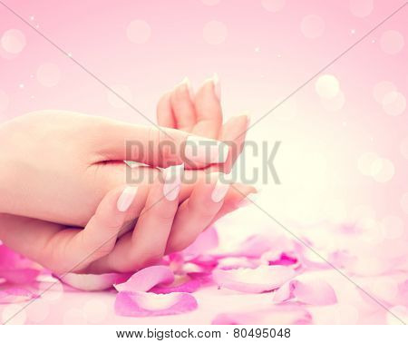 Manicure, Hands spa Beautiful feamle hands, soft skin, beautiful nails with pink rose flowers petals