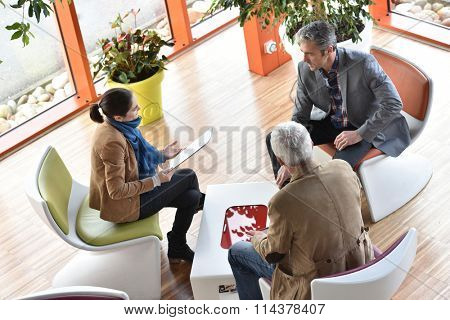 Business people gathering in meeting area stock photo