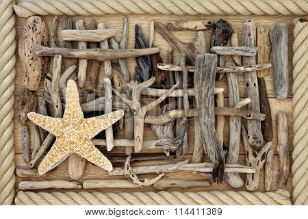 Driftwood and starfish abstract background over oak wood with rope surround. stock photo