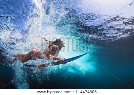 Underwater Photo Of Girl With Board Dive Under Ocean Wave