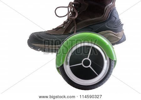 Big boot riding a modern motorised green hover board or self balancing scooter the new trendy mode of transportation isolated on white stock photo
