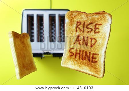 Good morning rise and shine on flying toast or toasted bread popping up from the toaster stock photo