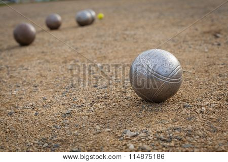 Petanque balls on a sandy pitch with other metal ball in the background stock photo