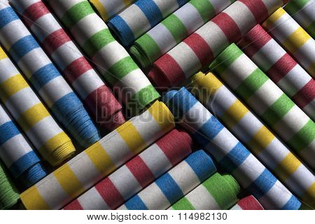 Party flings or Chinese Yo Yo are arranged to form a colorful abstract of stripes and color stock photo